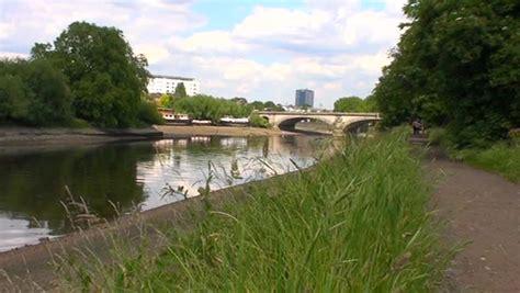 thames river kew westminster kew bridge over river thames middlesex london stock
