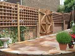 Pation fencing ideas for brick wall
