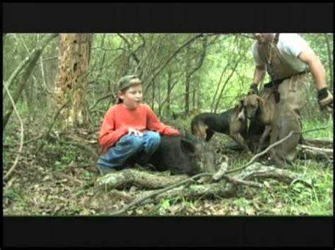hog 8 year boy kills hog with only