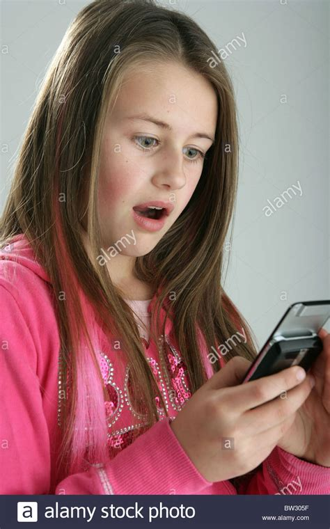 portrait of 10 year old girl stock photo getty images 10 year old girl looking shocked at a mobile phone stock