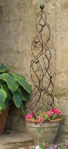 garden obelisk trellis metal gardens planters and birds on