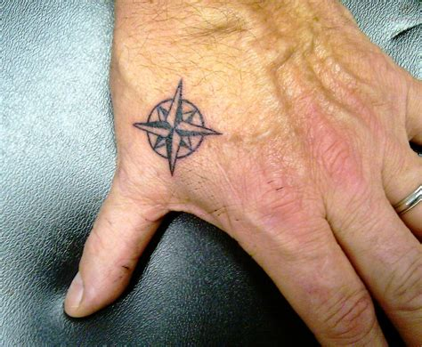 small heart tattoos on hand tiny compass on