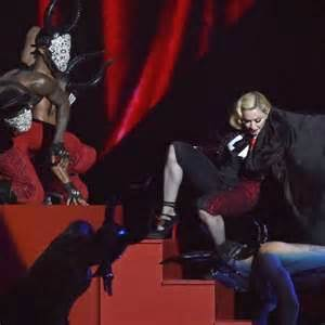 madonna falls stage after wardrobe malfunction during