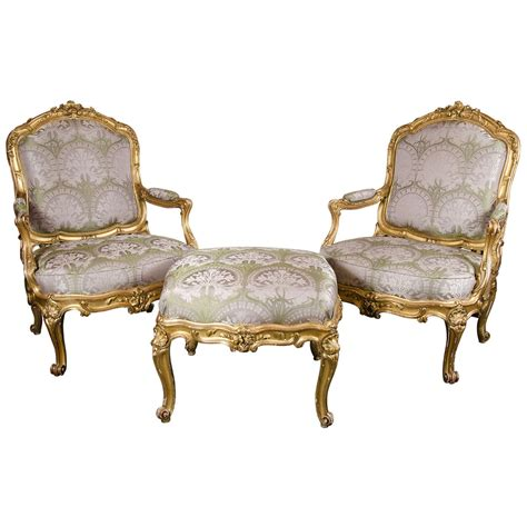 french bergere chair and ottoman pair of french bergere chairs and ottoman in gilded wood