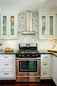 Kitchen Backsplash Ideas With Cream Cabinets carrara marble hexagon tile contemporary kitchen