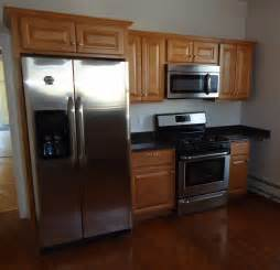 file newly renovated kitchen with cabinets refrigerator