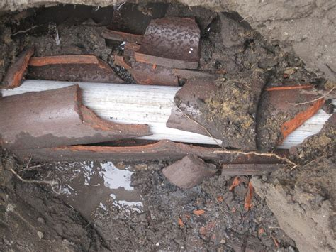 sewer pipe pulled thru clay sewer via trenchless