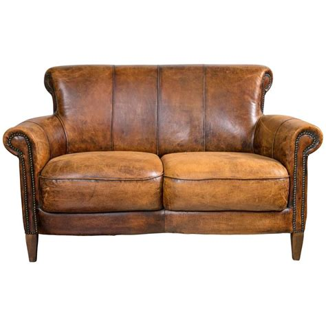 art deco leather sofa vintage french distressed art deco leather sofa at 1stdibs