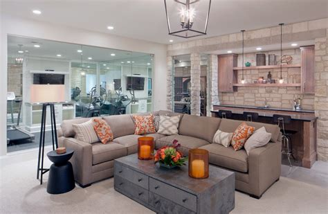 neutral transitional family room with curved sofa and grand rapids sectional coffee table family room