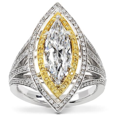 white yellow gold marquise engagement ring