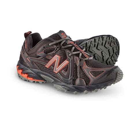 New Balance Black And Orance s new balance 174 573 trail shoes black orange