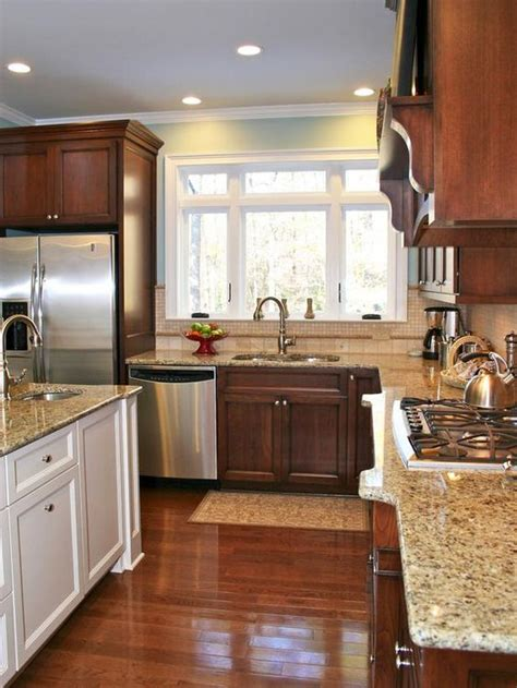 mixed kitchen cabinets kitchen cabinetry doesn t have to match a creamy white