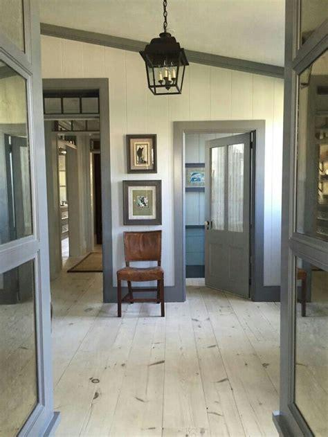 light cream paint dark grey greige trim grey walls white