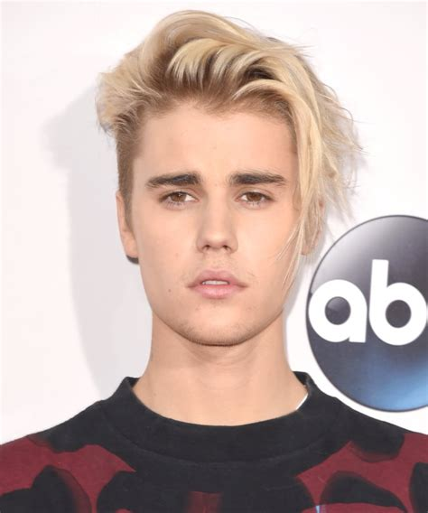 justin bieber has a tiny man bun now instyle com