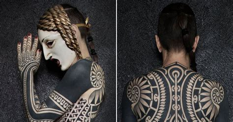 online tattoo on body woman covered from head to toe in huge intricate tribal