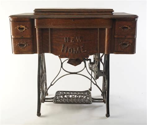 antique new home model d peddle sewing machine in quarter