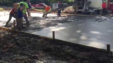 Garage concrete floor bull float and pouring concrete