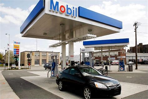 mobil record mobil records drop in revenue profit business the