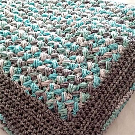 surface zig zag pattern crochet zig zag puff stitch baby blanket featured on crochetsquare