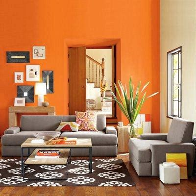 orange paint color ideas living room and grey sofa and table this may be a bit intense