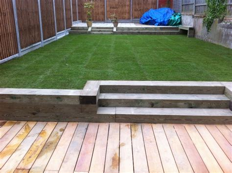 Securing Sleepers To Ground by Patio Turf Raised Sleepers Landscape Gardening In