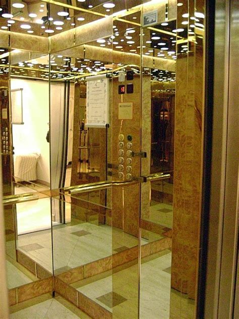 cabine ascensori foto cabina ascensore in acciaio oro radica e specchi di