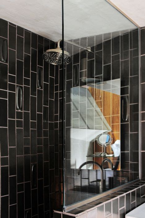 Black Showering by Hotel Lautner Black Tile Shower Bathroom Remodel Ideas