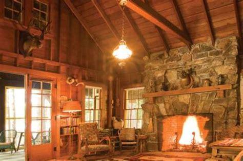the rustic stone fireplace . . . amazing adirondack designs!