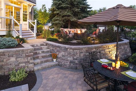 retaining wall to level backyard minnesota backyard paver patios southview design