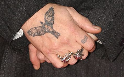 johnny depp tattoo on ring finger guess the celeb tattoo people magazine