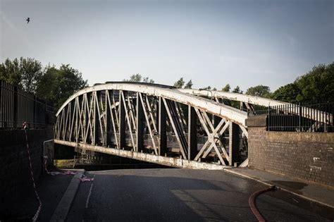 swinging bridge hotel trafford barton road bridge left jammed by summer heat open as fire