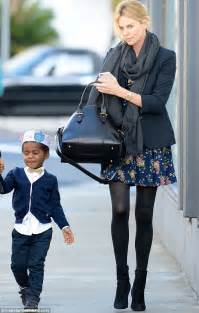 charlize theron s son dons a paper crown with mum and