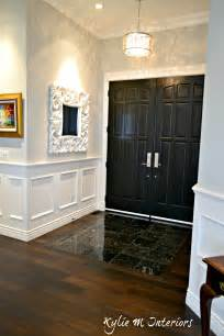 Tile Wainscot Entryway With Dark Wood Flooring Black Marble Tile And