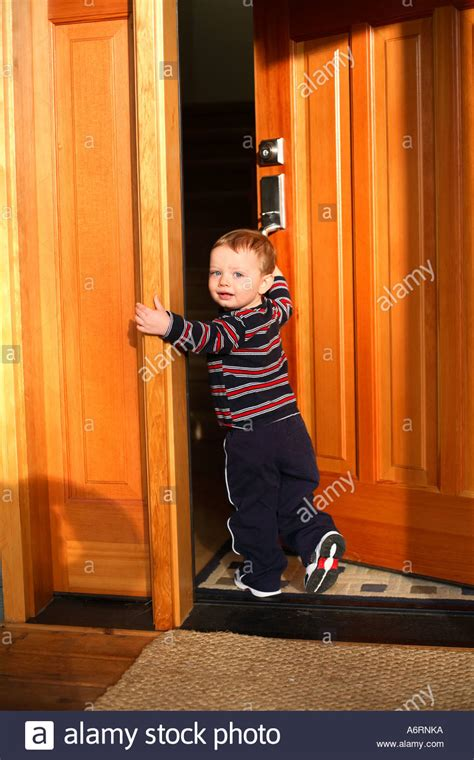 Walking Through The Front Door 18 Month Boy Walking In Front Door Of House Stock Photo Royalty Free Image 6650617 Alamy