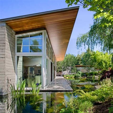 Sustainable House By The Pond Sustainable House Wraps Around Made Pond And Lush