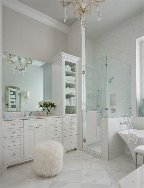 White Bathroom with Antiqued Mirrored Cabinets