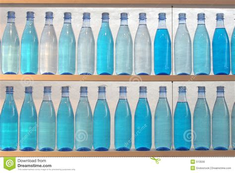Shelf Water by Bottles Filled With Water Standing On The Shelf Stock