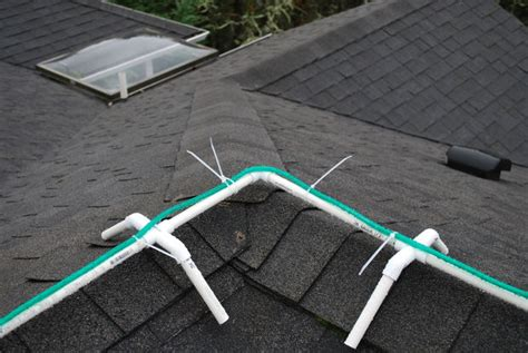 putting christmas lights on roof frame for installing rope lights on ridgeline of roof