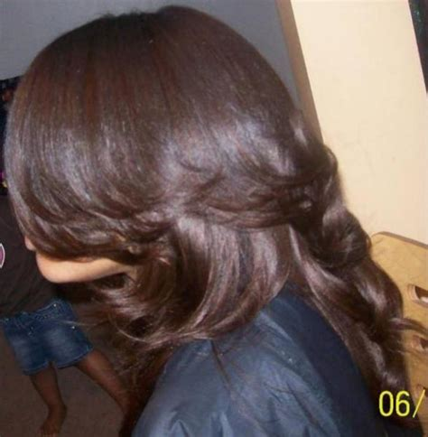 hair do with sew in weave with a part in the middle black sew in hair style thirstyroots com black hairstyles
