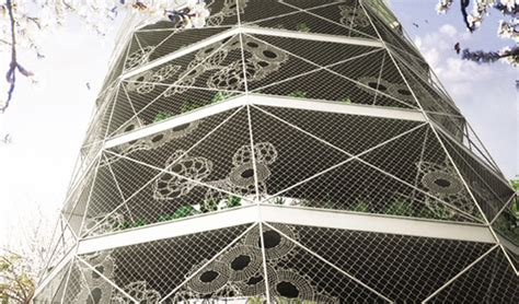 spiral garden is a lacy mesh vertical farm for the city