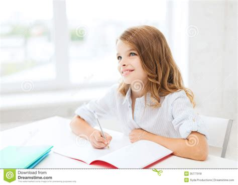 Gift For Architecture Student student girl writing in notebook at school royalty free
