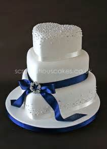 Unique Wedding Centerpiece Ideas Without Flowers - wedding cake 593 navy ribbon with piped dots and