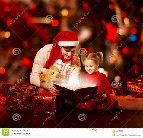 christmas family reading book father and child opening