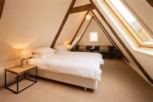 practical attic bedroom with low slanted ceiling mike