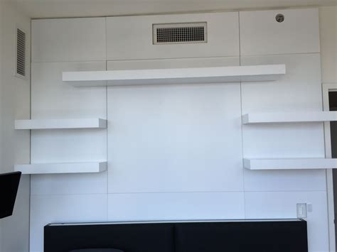custom floating shelves crafted wall unit with custom paneling and floating shelves by ezequiel rotstain design