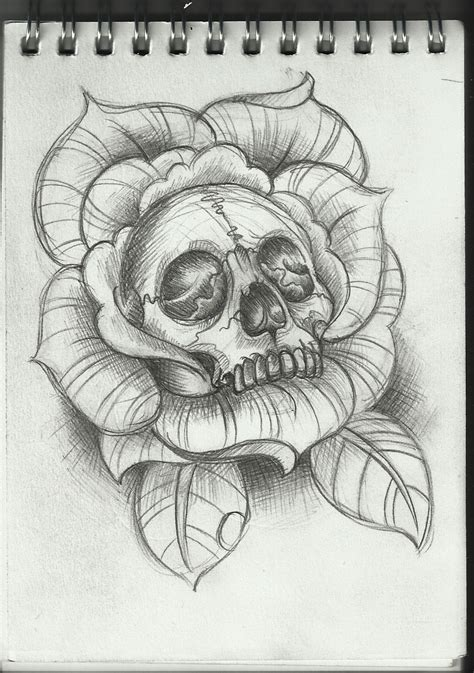 skull in a rose tattoo skull inside of a design tattoos
