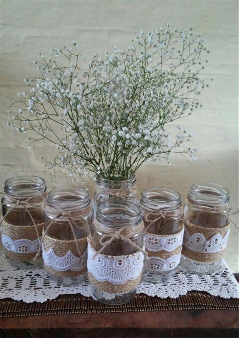 floreros con frascos de vidrio m 225 s de 25 ideas incre 237 bles sobre frasco de centros de mesa