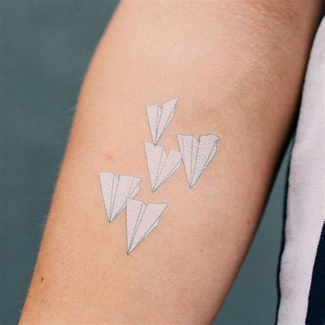 paper airplane tattoo meaning 25 best ideas about paper airplane tattoos on