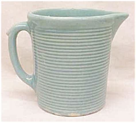 weller pottery pitcher green ribbed porcelain  pottery