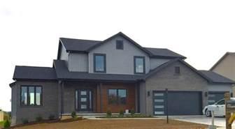 black siding houses mastic deep granite grey siding black trim cedar siding black garage door certainteed